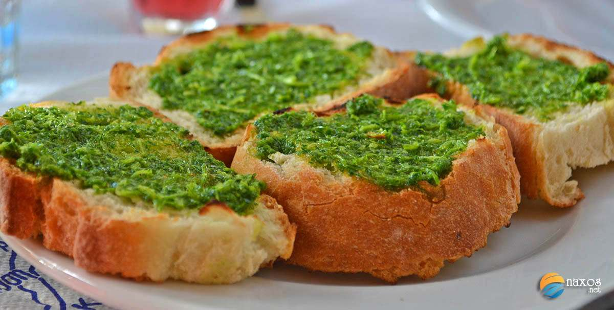 Tasty food on Naxos. Freshly baked bready with parsley and garlic pesto.